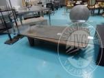 Immagine di Fall. Mann & Rossi Sas n. 327/2017 - Tavolo basso con base in legno vecchio 83 x 160 e piano superiore in cristallo 115 x 190 (lotto 24)