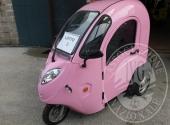 Triciclo elettrico con cabina chiusa