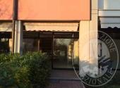 Lotto 1: diritto di superficie di negozio con pertinenze in Parma
